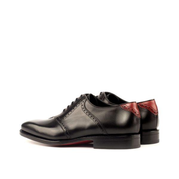 red heel tab details on black Saddle Shoes VLAD