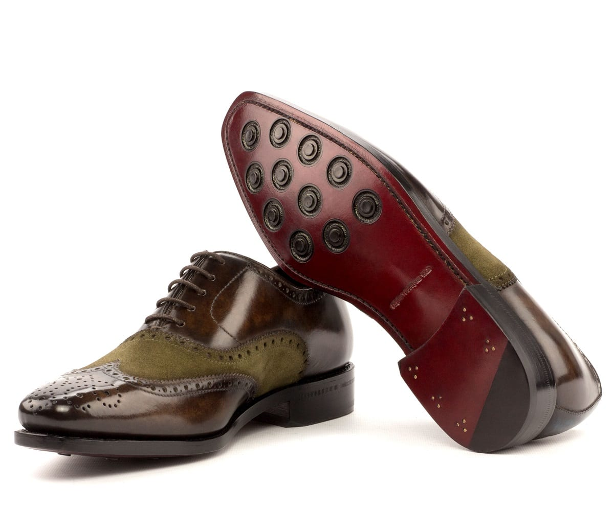 Goodyear welted leather sole with rubber button inserts